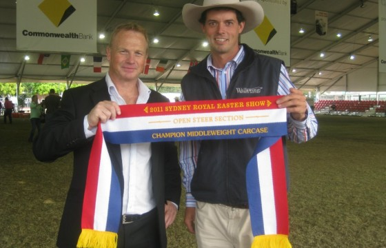Alistair Watson Coles Meat manager presents Champion Middleweight carcase ribbon to Lachlan James